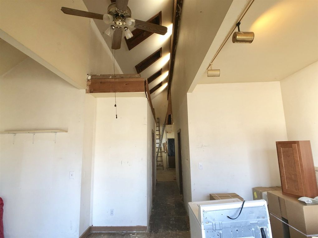 Standing in the living room, looking down the hallway with bedrooms to the left and right