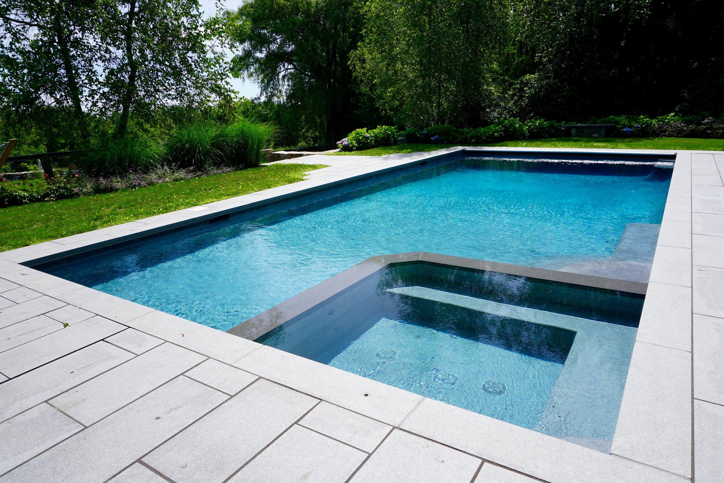 In-ground custom gunite pool with spa