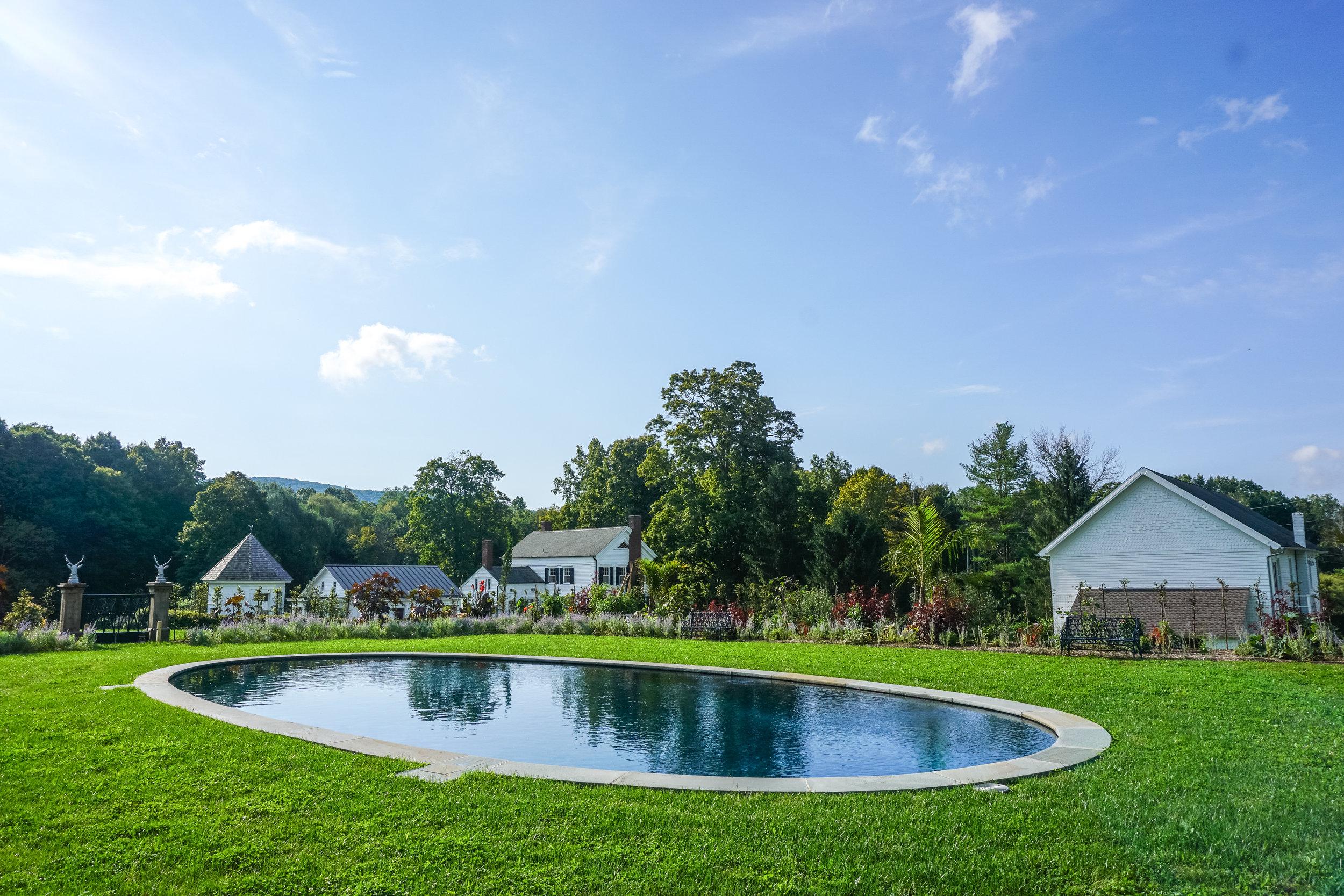 In-ground custom gunite oval swimming pool