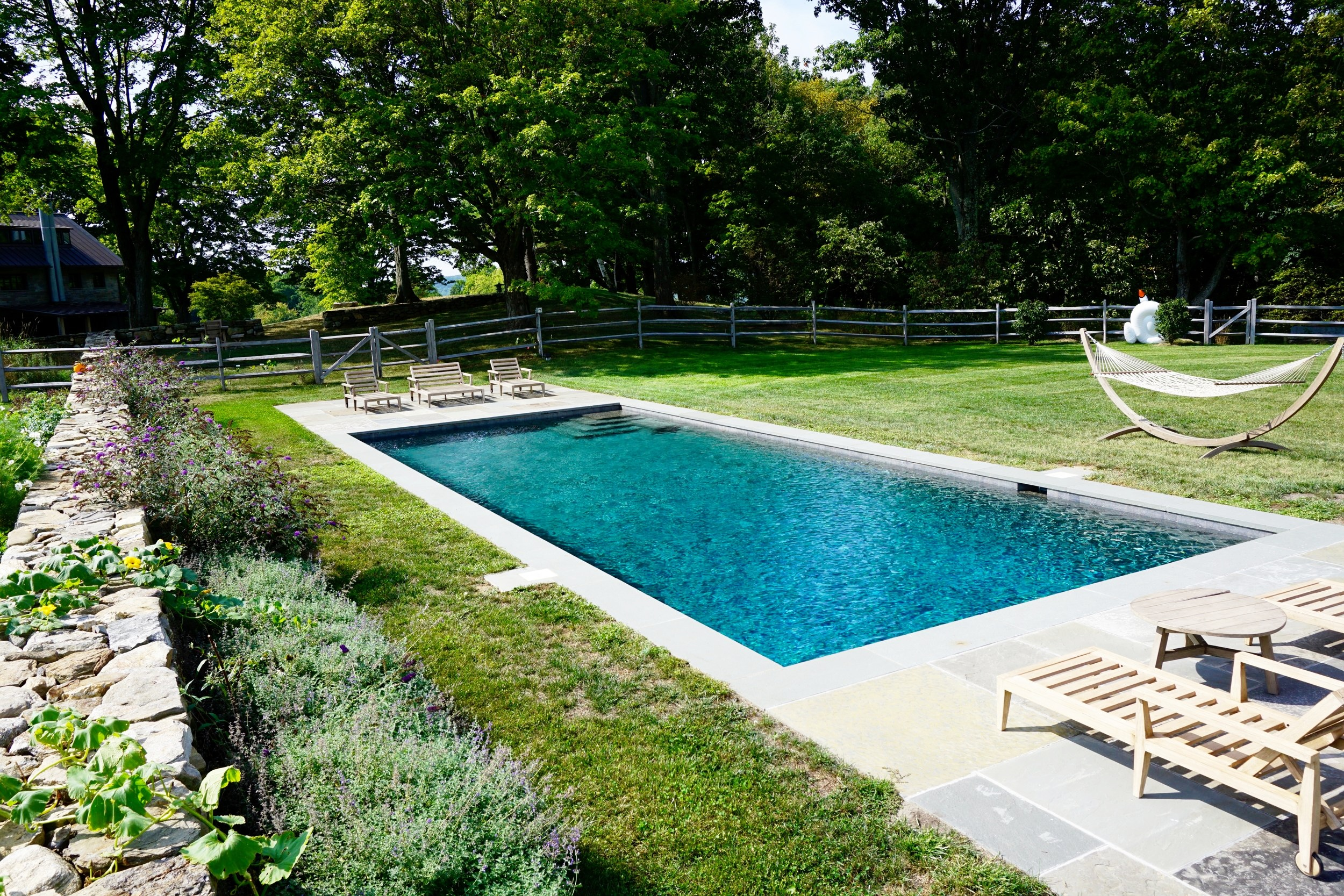 A pool without an automatic pool cover