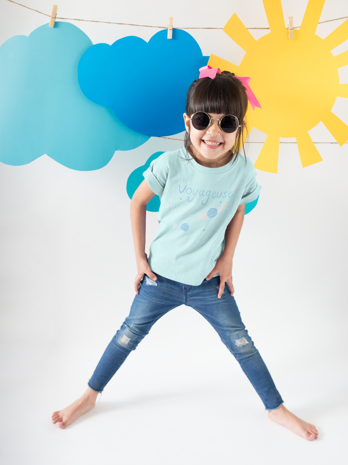 happy-girl-wearing-a-t-shirt-mockup-and-round-sunglasses-under-sky-decorations-a19478.png