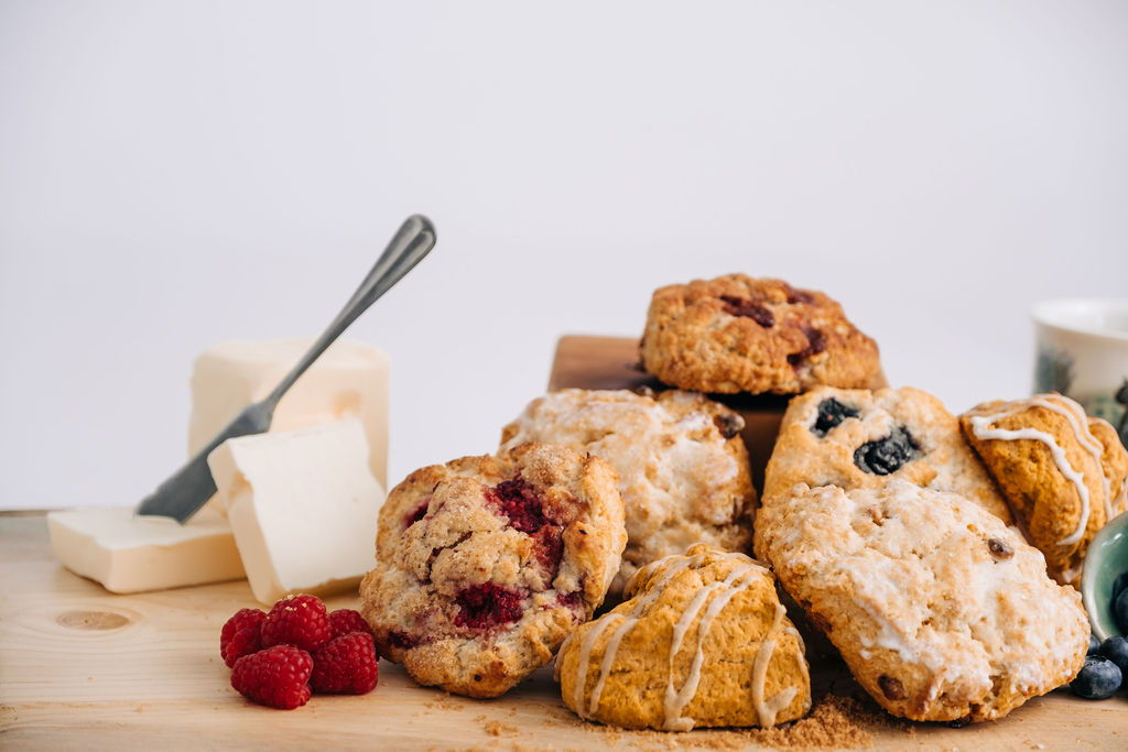 Scones - Our scones are made with sweet cream butter, heavy cream, and a variety of fruits, chocolate, or nuts. Featuring flavors like Snickerdoodle, Blueberry Lemon, Mocha Chip, and Sea Salt Caramel!