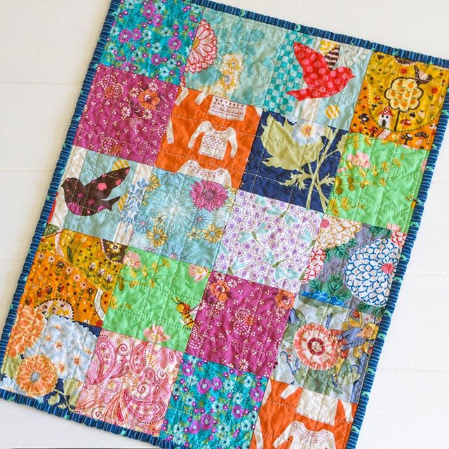 I just love this little dolly quilt I made last year. It's so cheerful. It was for a client, I've got to make one for my daughter.