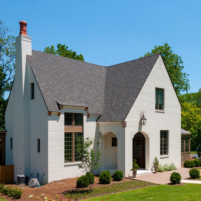nash_circle_crestline_mountain_brook_alabama_new_residence_01_front_entry_porch_elevation_den_chimney_gable_painted_brick_1500.jpg