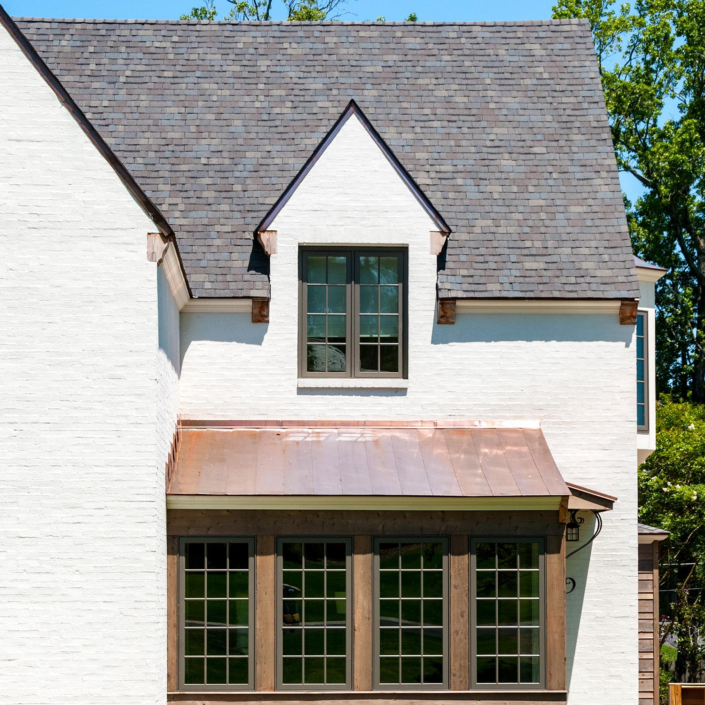 nash_circle_crestline_mountain_brook_alabama_new_residence_07_banquette_copper_bay_dormer_elevation_painted_brick_1500.jpg