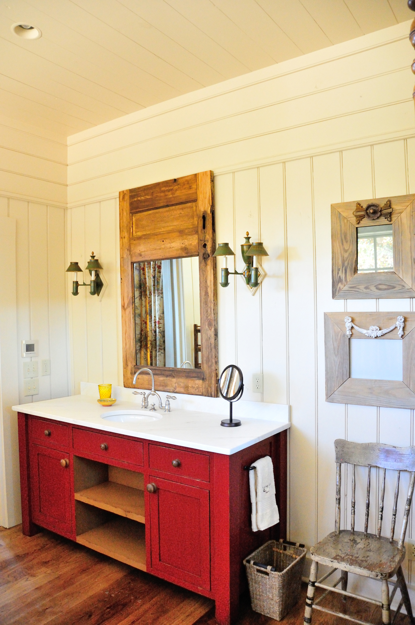 longridge_farm_lakehouse_03_lake_house_her_master_bathroom_bath_room_vanity_wood_panel_1300.jpg