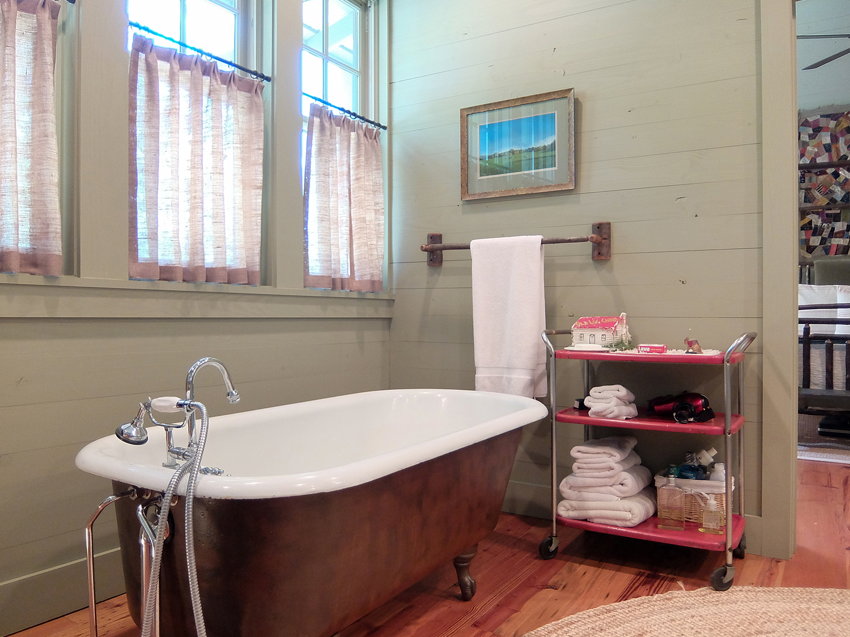 sugar_creek_farm_43_lakehouse_lake_house_master_bathroom_claw_foot_tub_farmhouse_1500.jpg