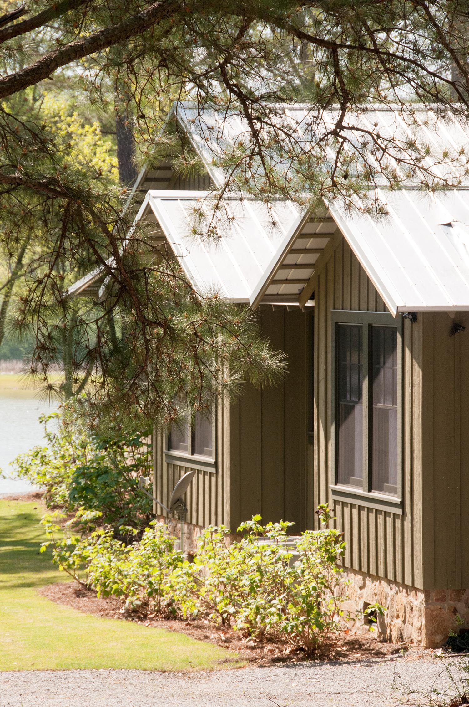 sugar_creek_farm_51_lakehouse_lake_house_guest_bedroom_farmhouse_view_tin_roof_1500.jpg