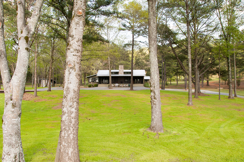 sugar_creek_farm_57_lakehouse_lake_house_front_entry_screened_porch_farmhouse_stone_chimney_tin_roof_1500.jpg