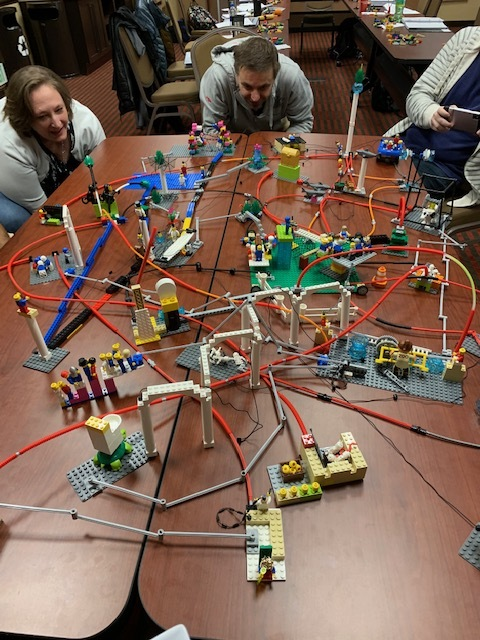 """So, What's LEGO® SERIOUS PLAY®? - Creates FlowParticipants become fully immersed and involved in the process.""""Think through your fingers""""80% of the brain is dedicated to your handsCreate a Story Using MetaphorsThe model tells the storyEveryone Contributes and Gives Their PerspectiveInstructionism Turns Into Constructionism"""