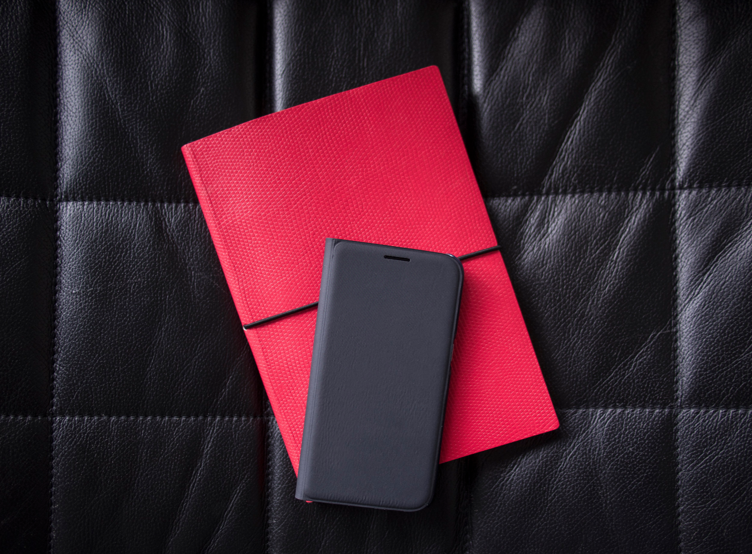 Red diary and black phone