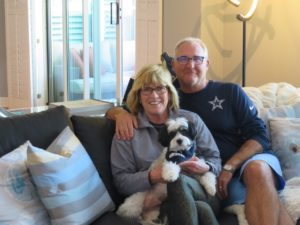 Michelle Boggs, CEO of Mutts, with her husband, Ron Roys and pup, Cobi.