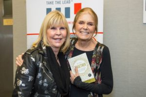 "Dr. Nancy O'Reilly (left) with Gloria Steienem holding her new book, at the recent Take The Lead fundraiser, ""Gloria: A Life."""