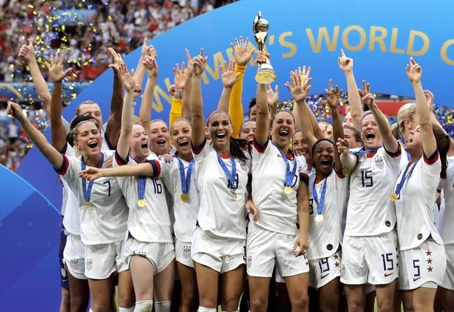 The USWNT celebrate their 4th World Cup. (Photo Credit: Alessandra Tarantino, AP.)