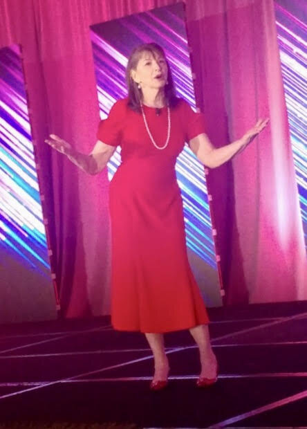 Yes, I was the speaker in the red dress who walked around on the stage.
