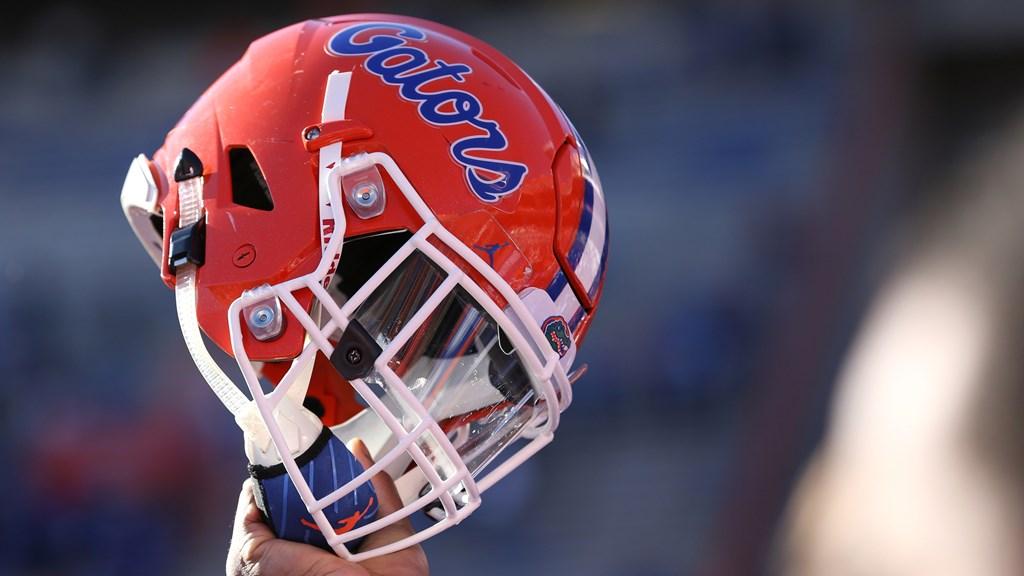 Florida player raises his Gators helmet.  Photo courtesy of floridagators.com