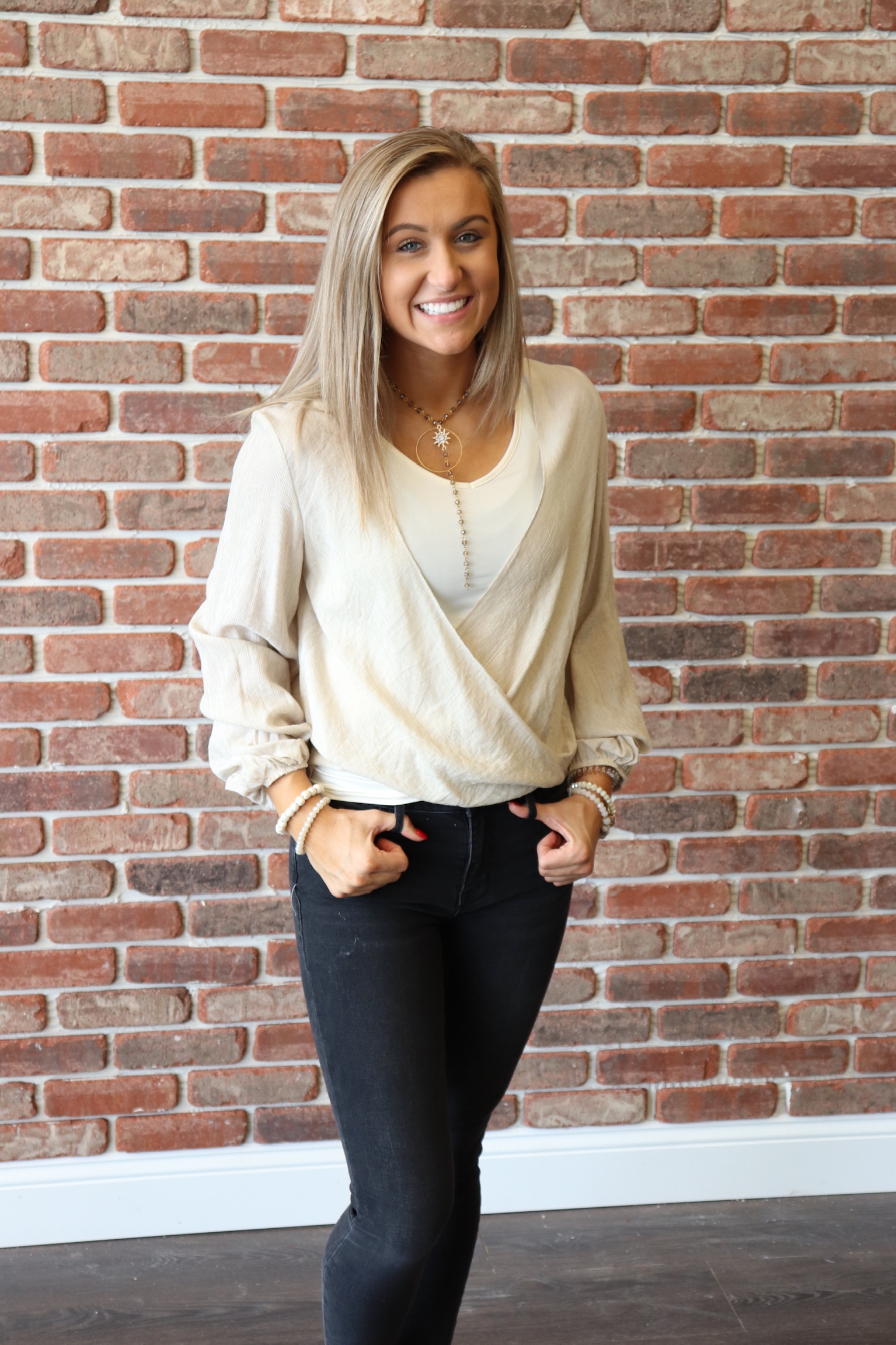 On the more casual side, Sadie is rocking our open front Natalie top. It looks so cute paired with jeans and a pair of mules. Add a Gypsy Gems necklace to make a bold statement!  This look is available in store and will be online soon! Call to order in the meantime.