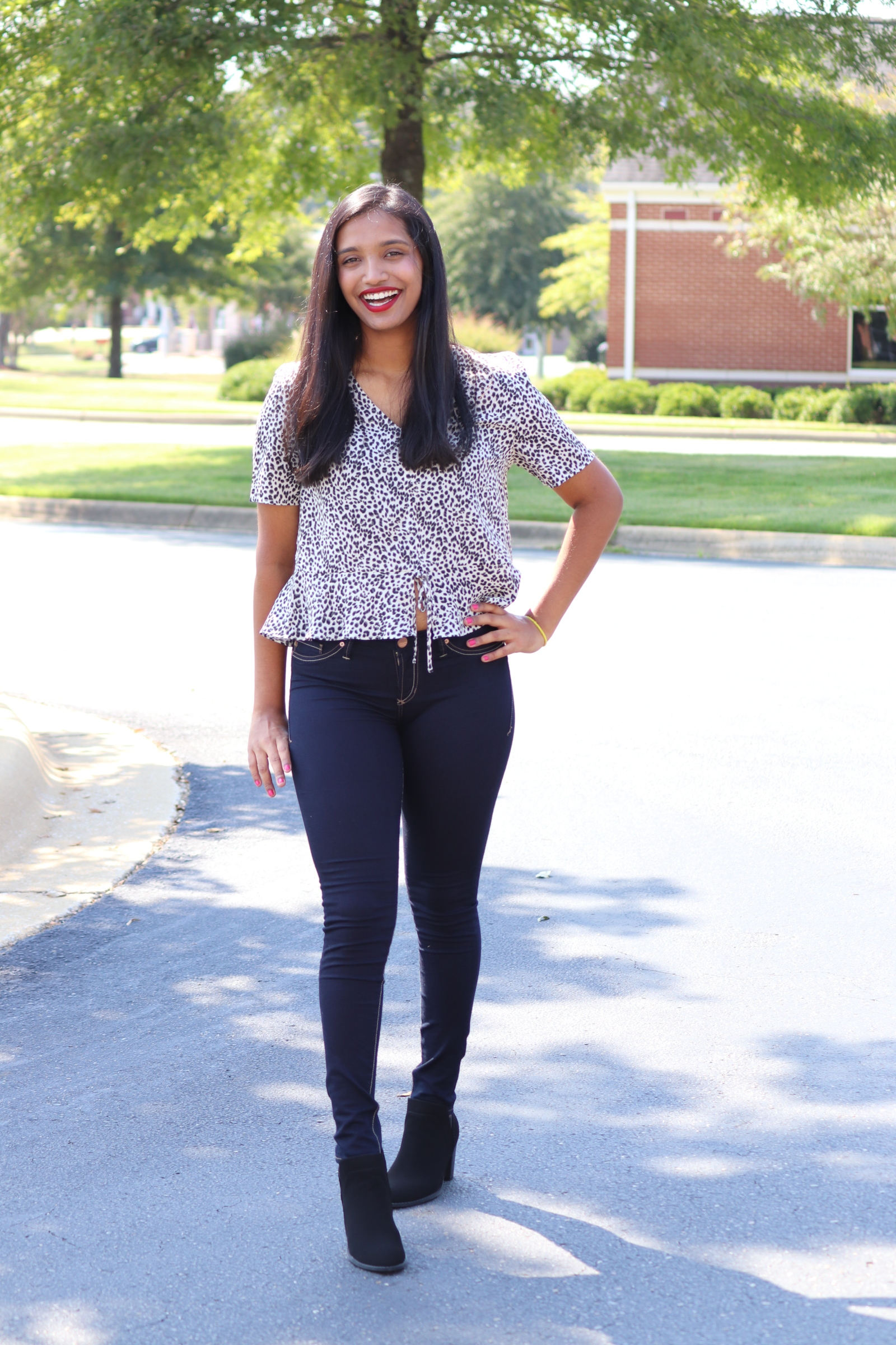 Reshu is rocking one of our favorite fall transition outfits. This leopard peplum crop top is lightweight and pairs perfectly with our dark wash Dear John denim and classic black booties. Once the cooler temps hit, just add a cropped black jacket or long cardigan and you're all set.  Grab this outfit in store today!