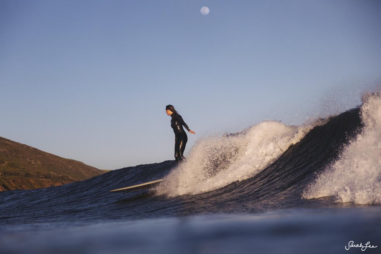 Anna Ehrgott surfing Malibu County