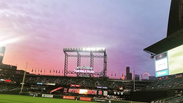 A beautiful sunset as a backdrop for the pink and blue sign of T-Mobile Park. . . . . . . . . . #baseball #mariners #truetotheblue #seattle #sunsets #T-MobilePark #Seattle