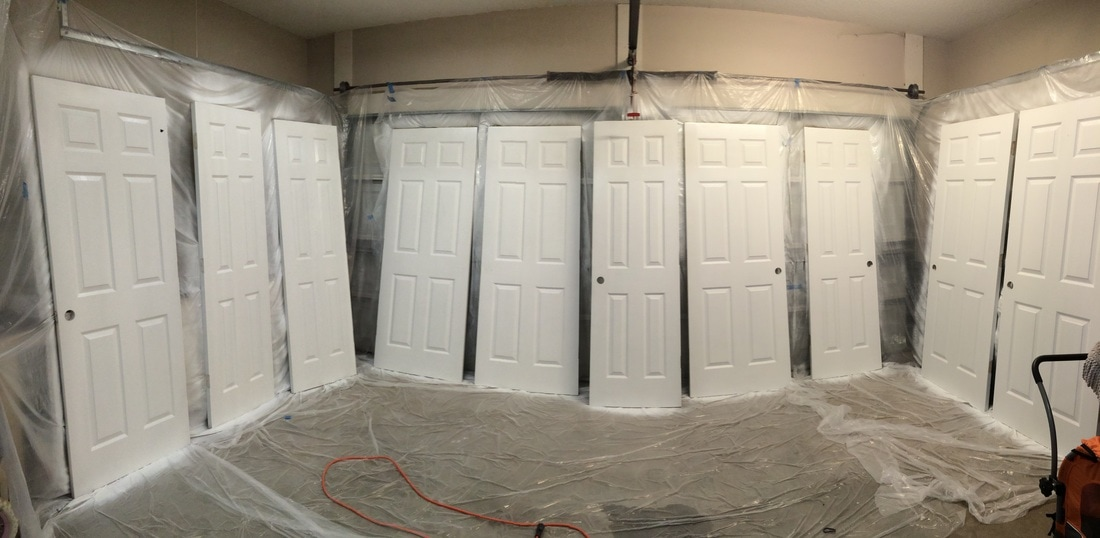 Getting the doors off of the hinges and into the garage and hanging plastic did take some time, however painting these doors with the sprayer took no time at all. So worth it!