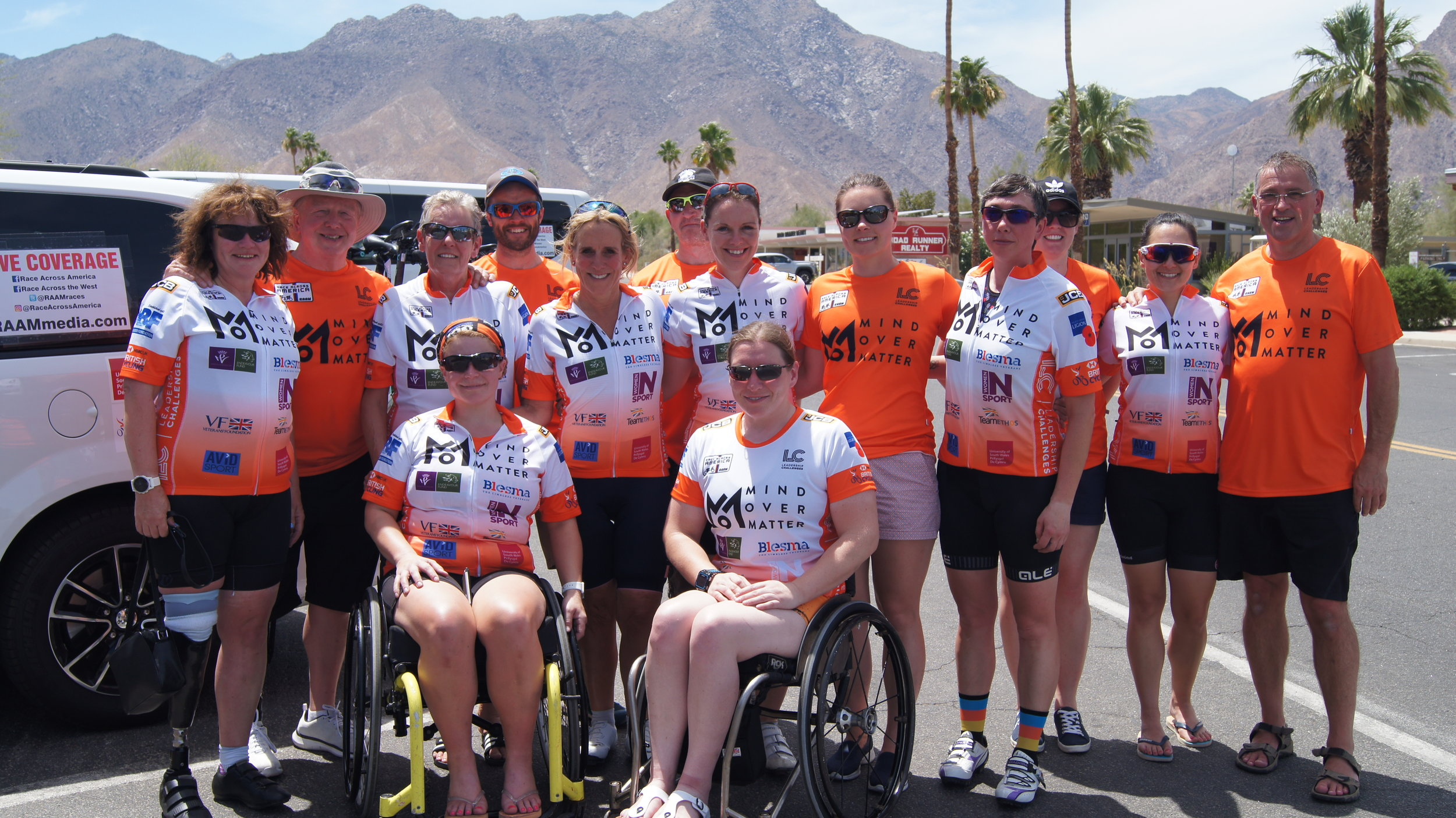 Riders and support team after the descent into the desert