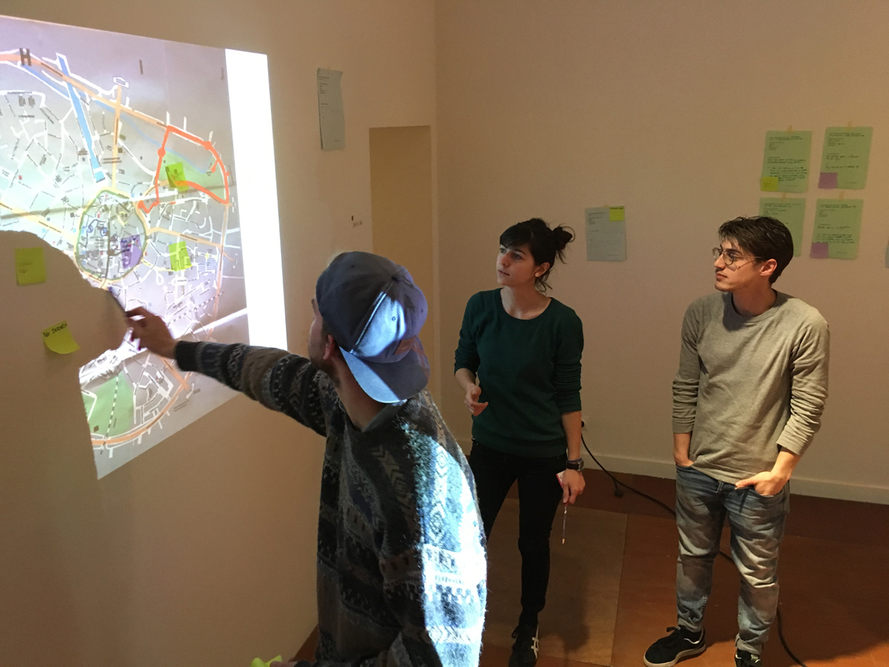 The first workshop, taking place at the  TRADERS Open School  on April 24 2017, first saw all participants out and about in Hasselt asking citizens to tell them lies and where to go next. The session concluded with a synthesis session that saw insights emerge from the collective pool of lies and their mapping unto the city. Above: Workshop participants Stef Lemmens, Maria Tsaneva, and Gino Bodt discussing and mapping what the city isn't.