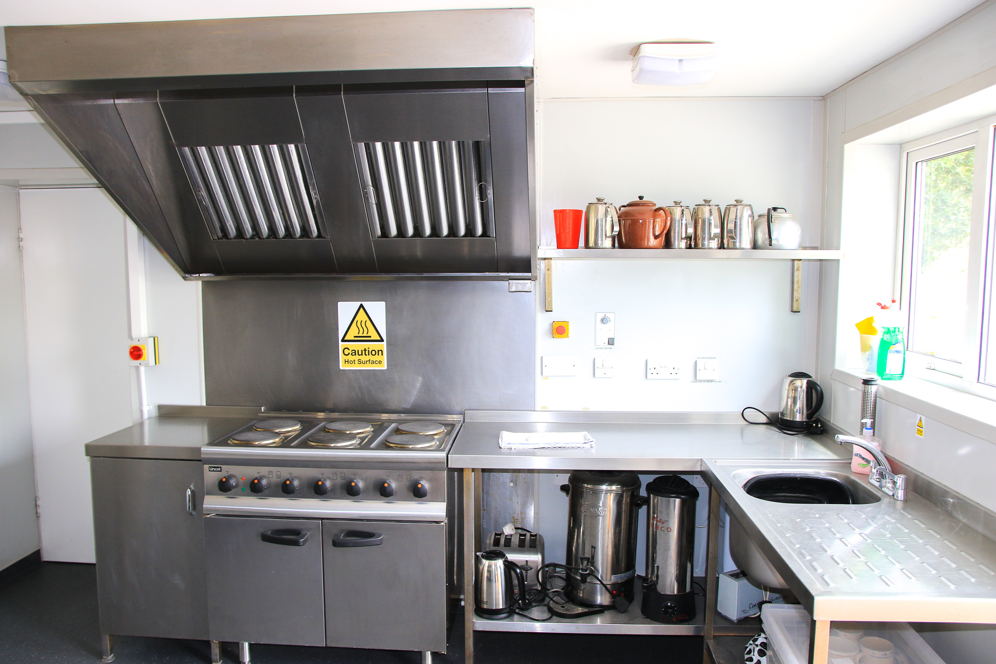 Commercial grade kitchen with electric oven, extractor hood, kettles, hot water urns and toaster