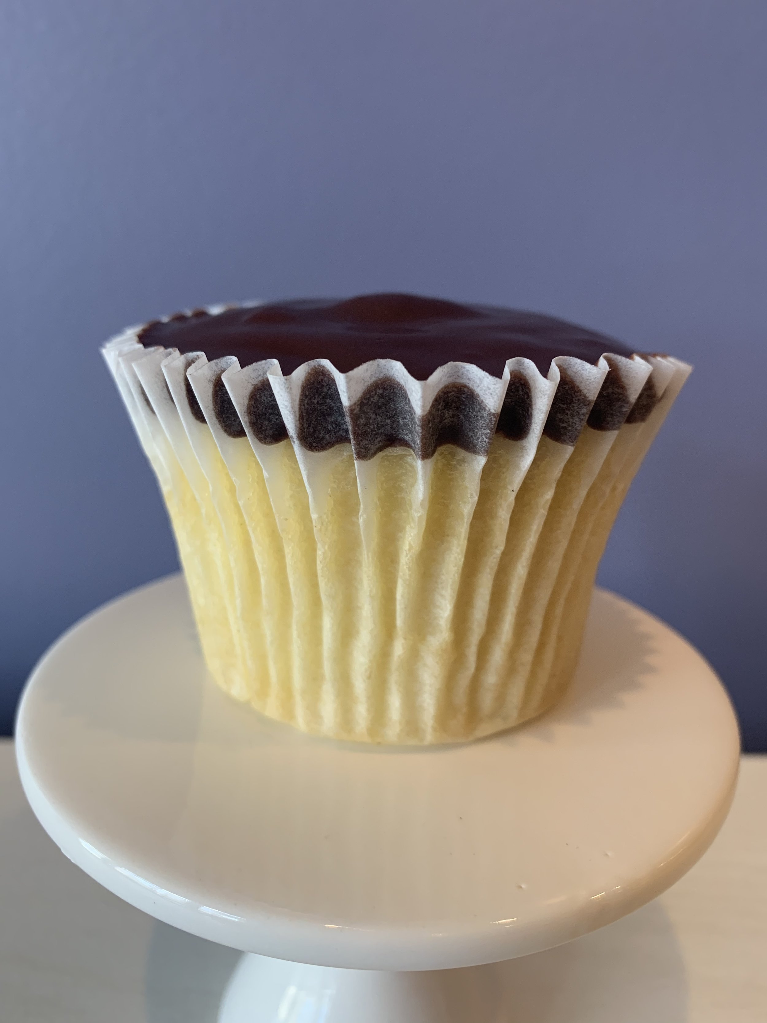 Boston Cream - Yellow Cake filled with pastry cream topped with chocolate ganache.Vegan and Gluten Free available
