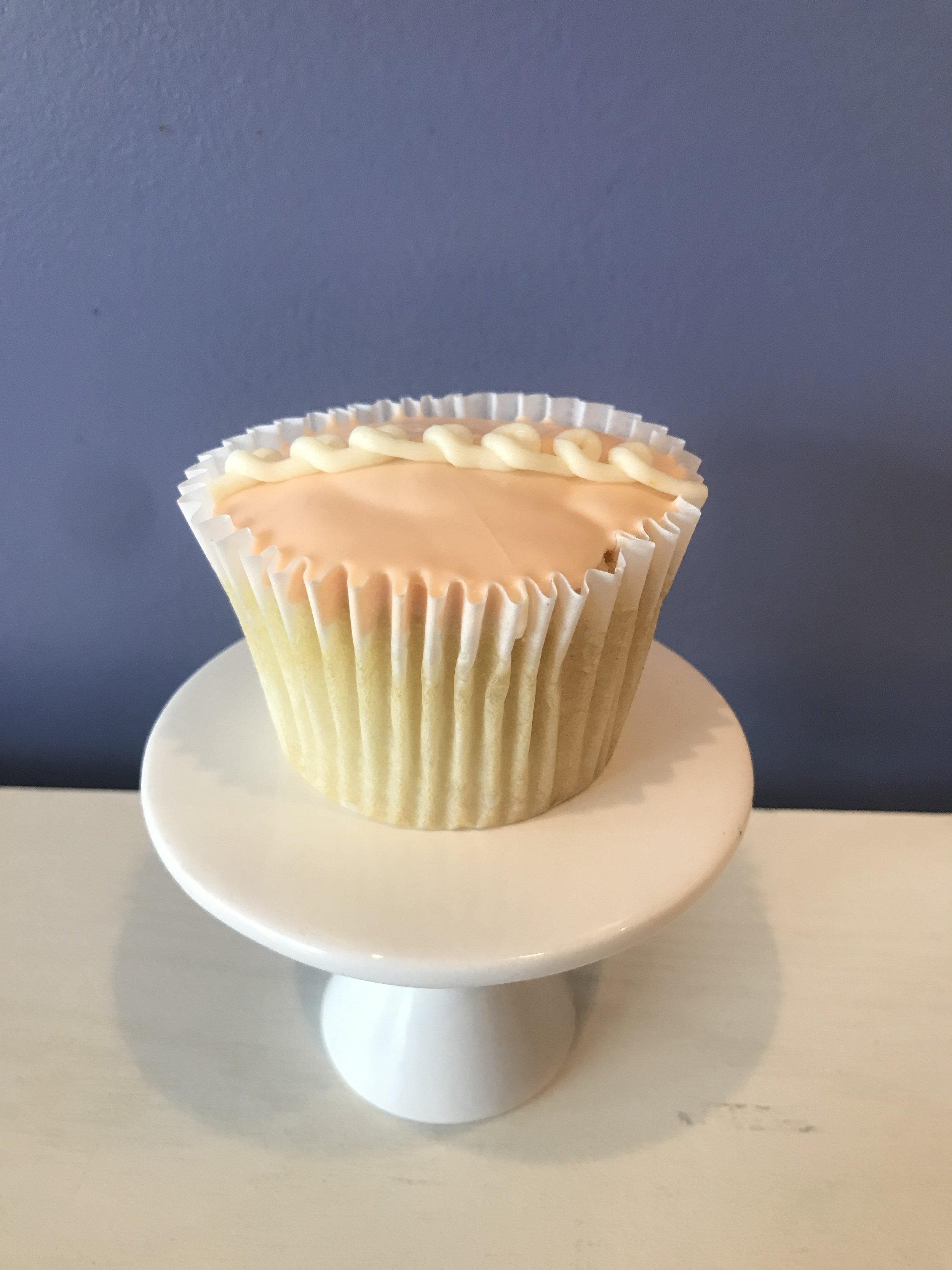 Orange Lunchbox - Vanilla cake filled with orange buttercream, topped with orange glaze.Vegan and Gluten Free available