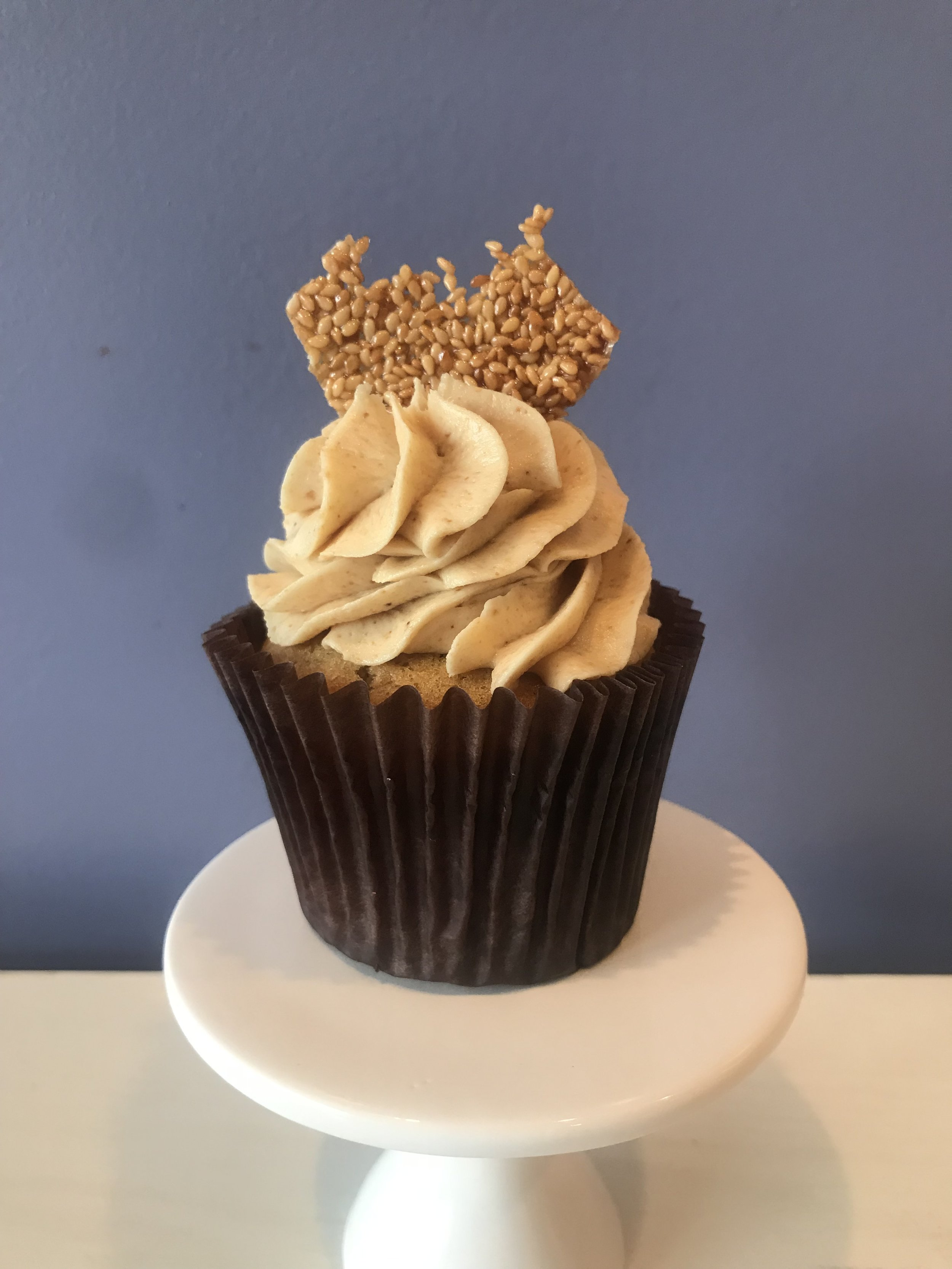 Sesame - Brown sugar cake topped with homemade tahini buttercream and a shard of crunchy sesame brittle. Our Sugar Showdown winning cupcake!