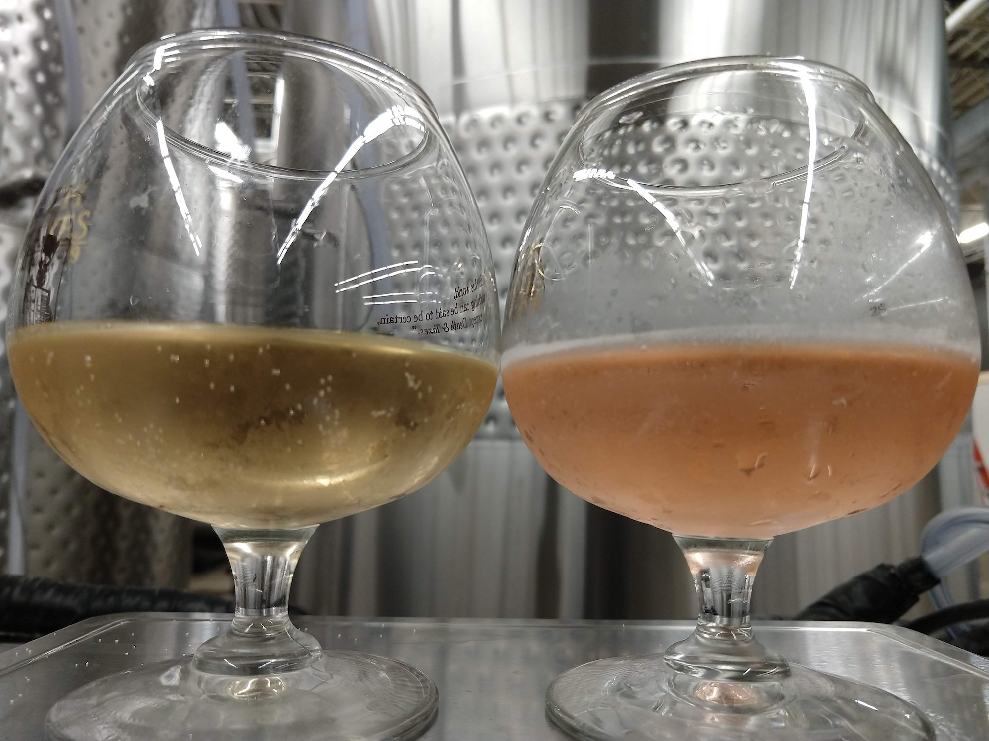 Here's a picture with two samples of our tart cherry cider poured from the same tank. The only difference is that the one on the left has a little bit of added acidity. They both have the exact same amount and type of anthocyanin pigment, but the pH is different due the added acidity, and thus the color is drastically different.