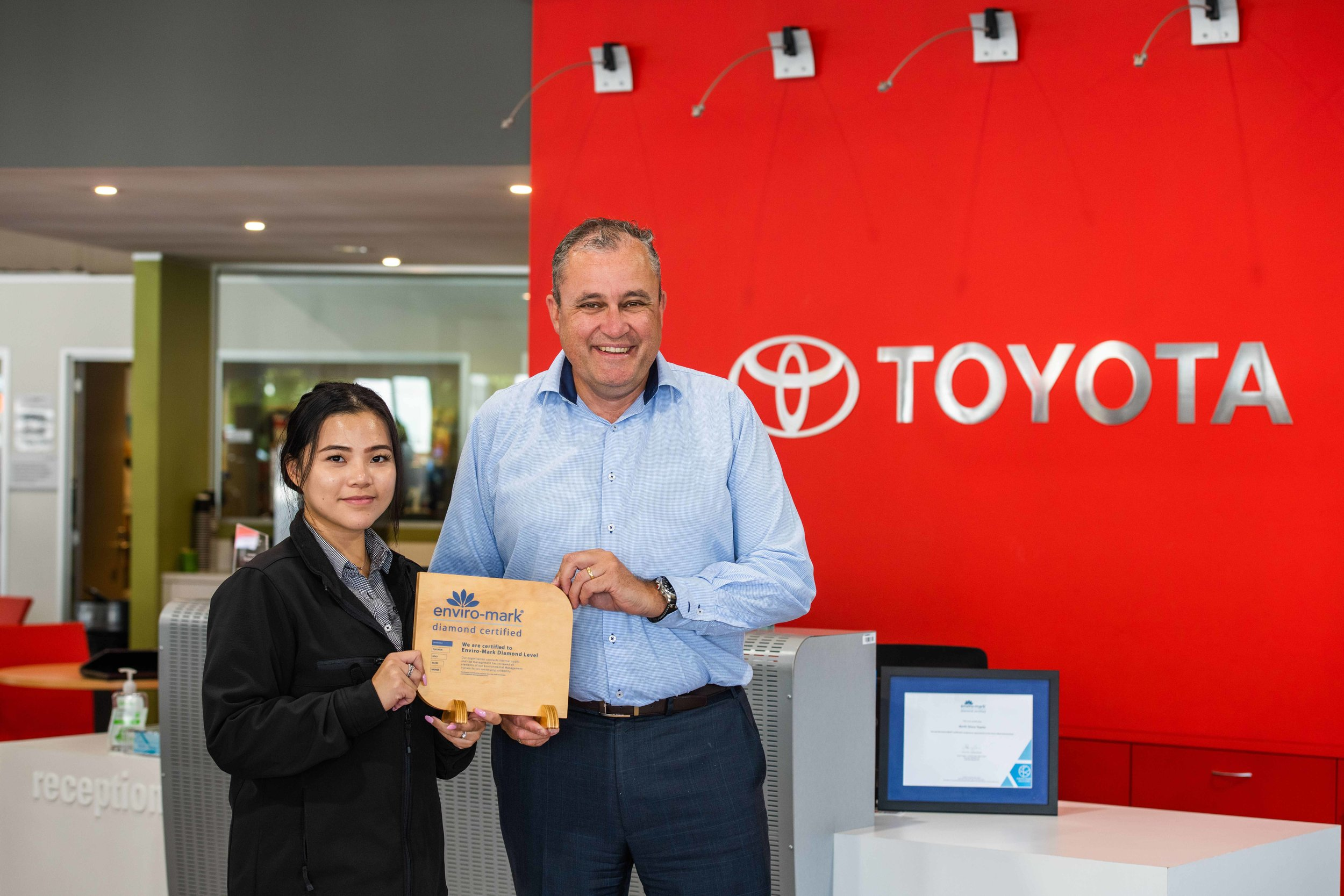 IMAGE_Nicole Choy and Mark Jago, CEO of North Shore Toyota with their Diamond certified Enviromark plaque .jpg
