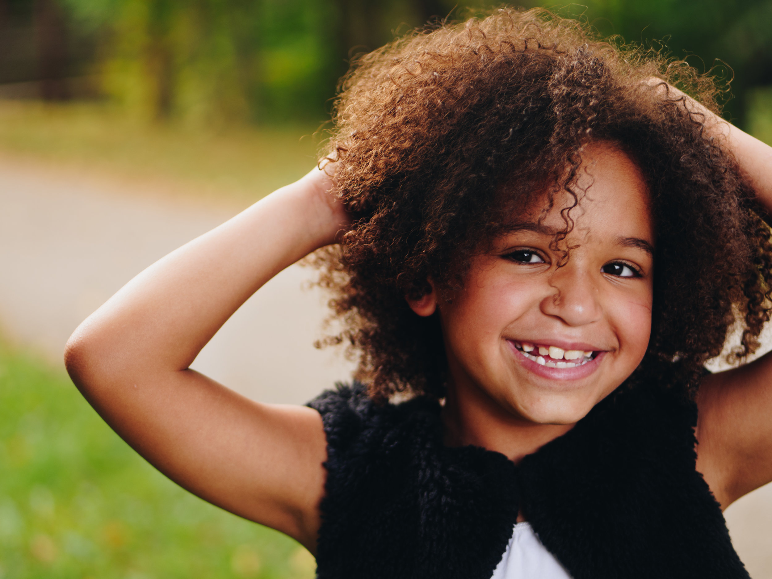 Young girl smiling on the Myofunctional Therapy page