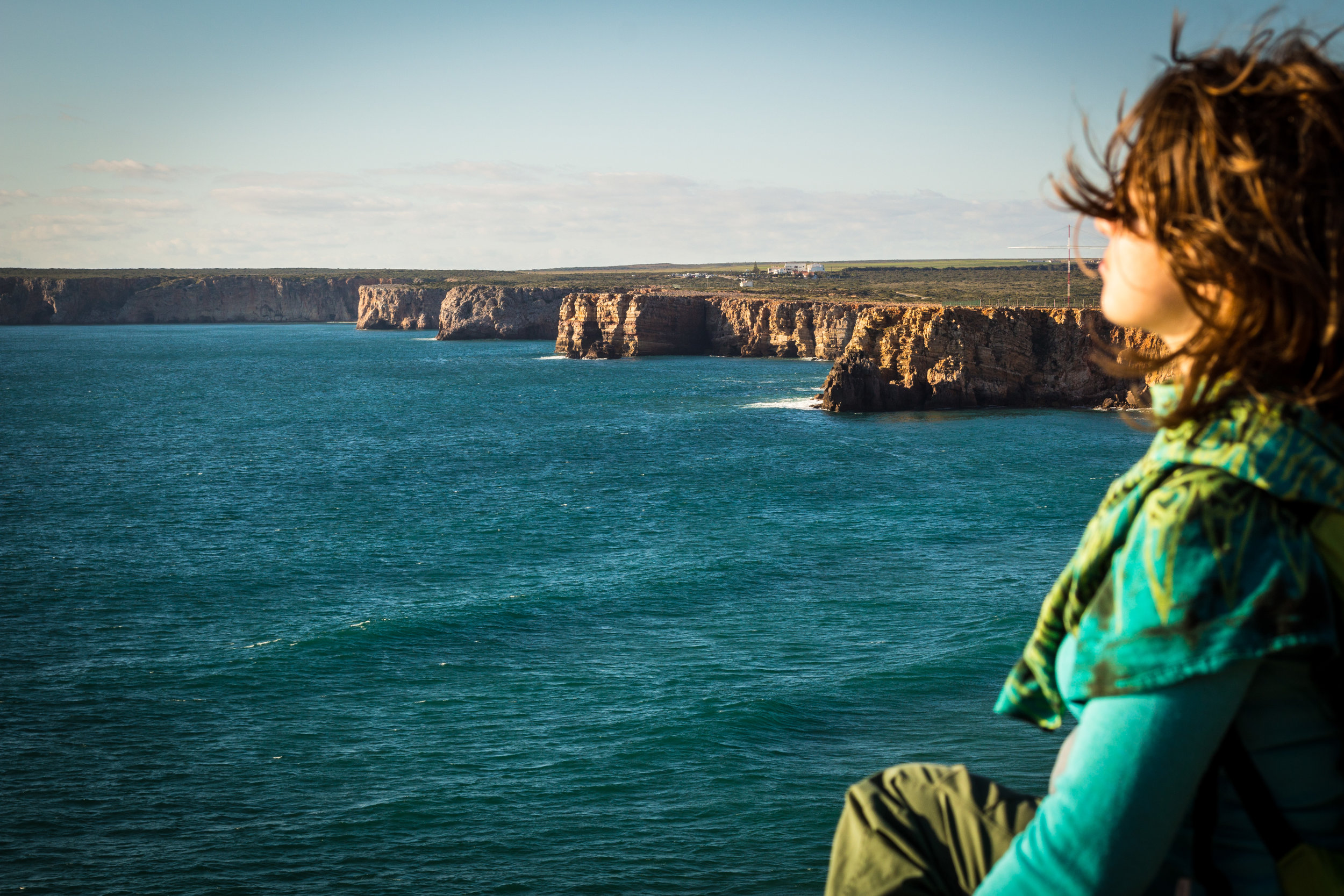 Woman on cliffs breathing - at the top of the Why Breathing Matters page