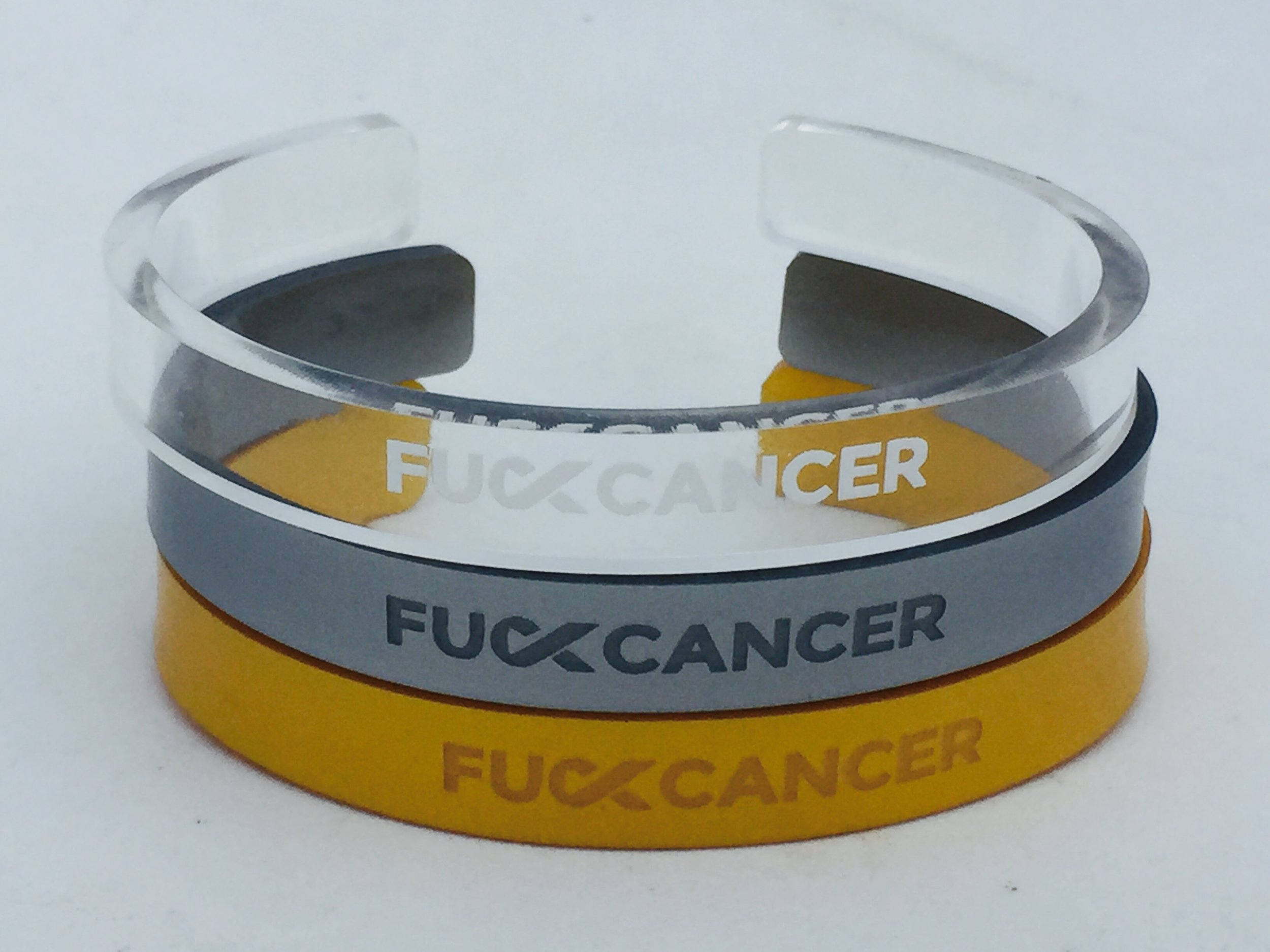 F Cancer now - Please visit SHOP F CANCER to purchase our handmade Lucite cuff designs. Proceeds go to this incredible organization to help all affected by cancer.