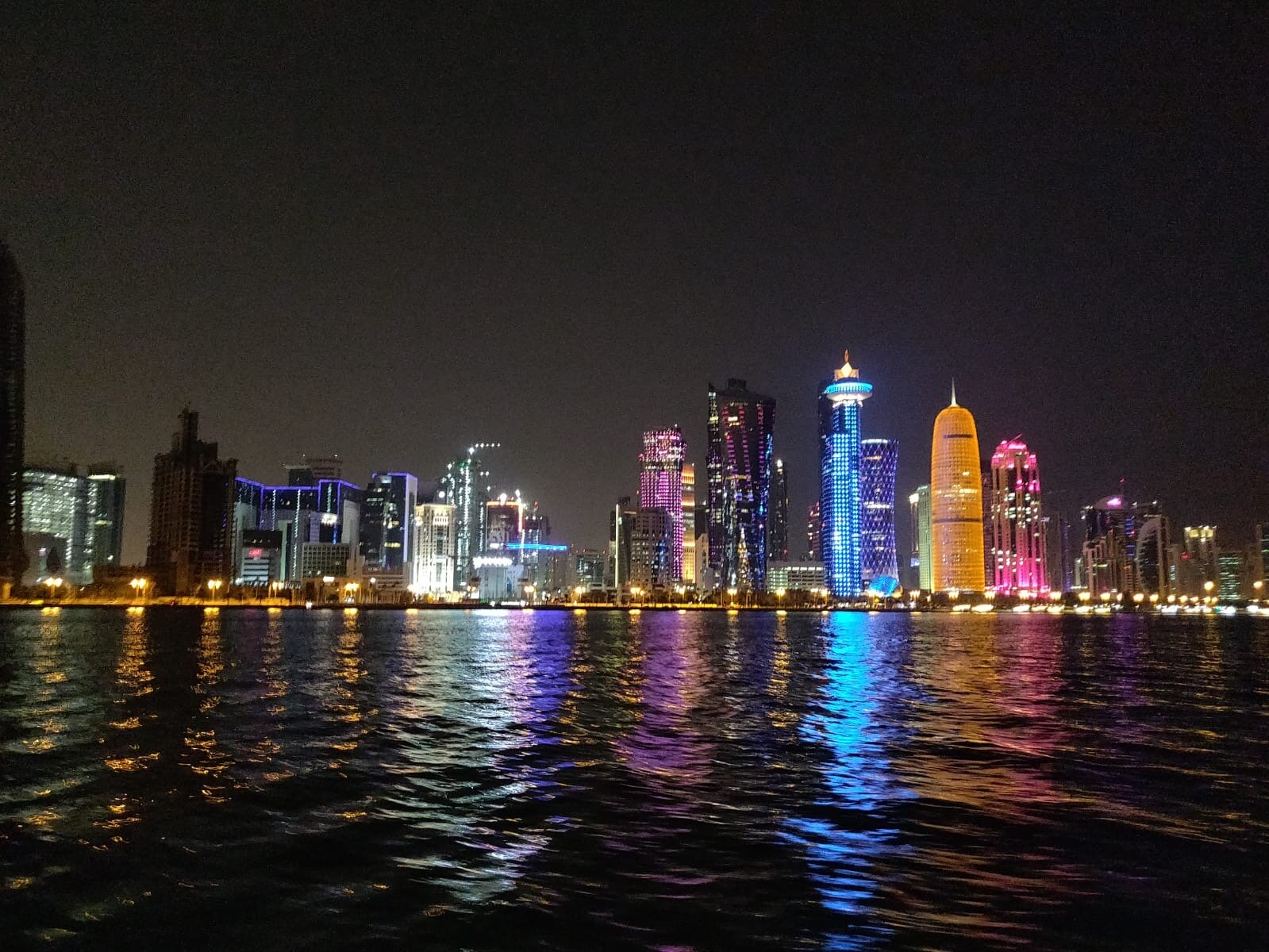 At night Doha glistens like gems along the water.