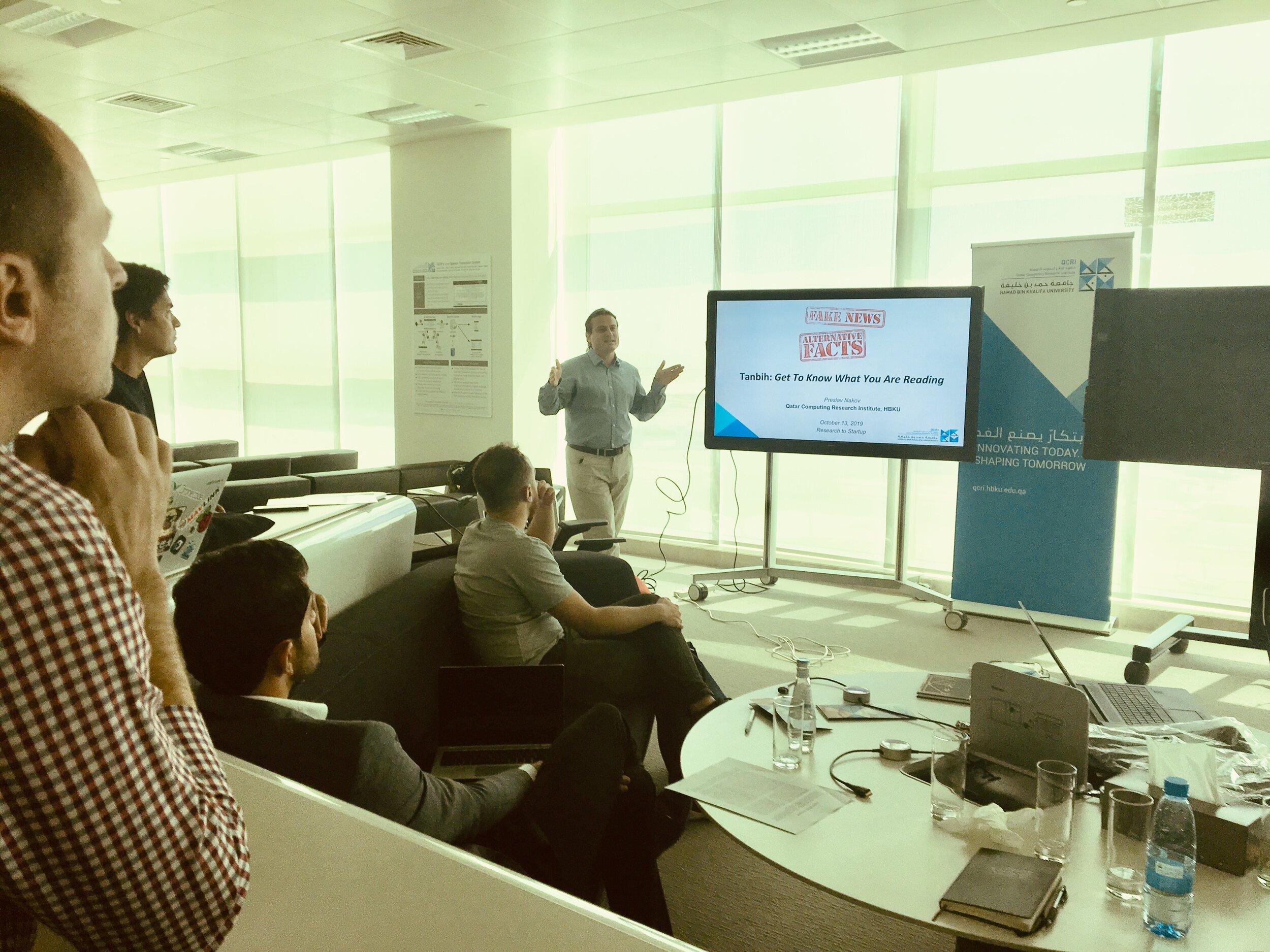 Sitting in Preslav Nakov's presentation on countering fake news and propaganda with AI.