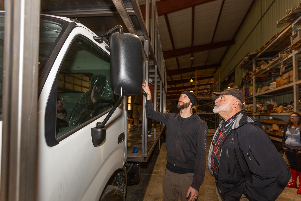 Chase Putnam from Tesseract shows details to owner Steven Gluckstern