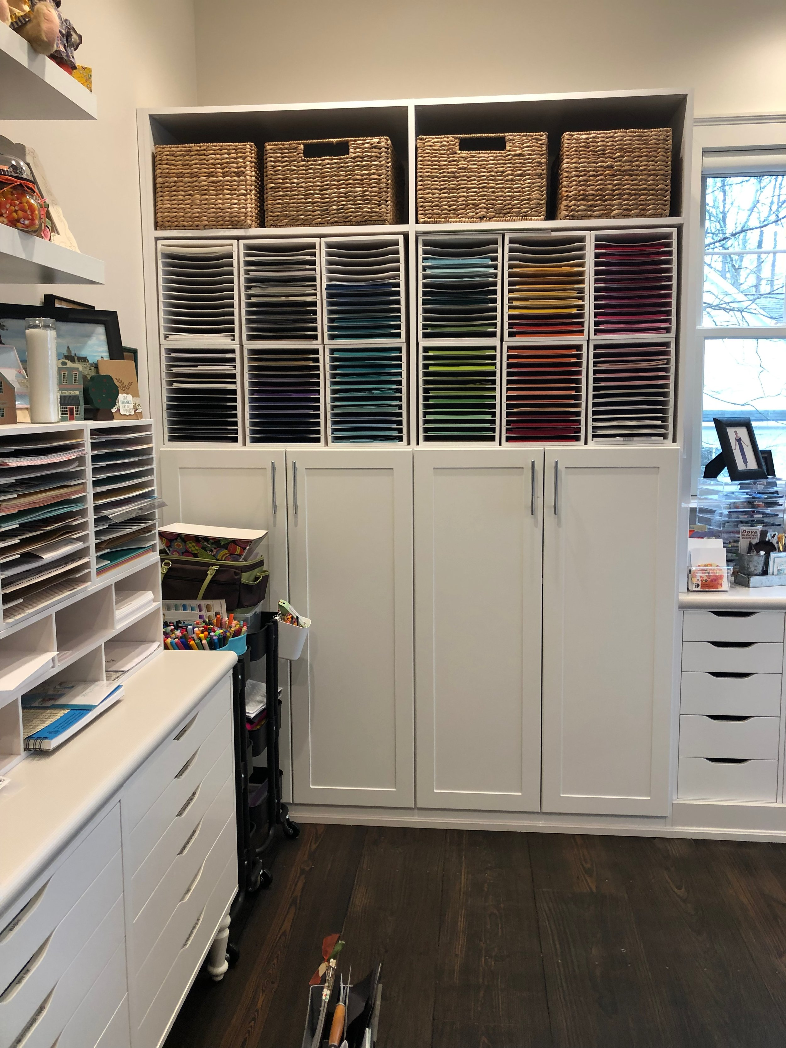 paper storage above and in cabinet