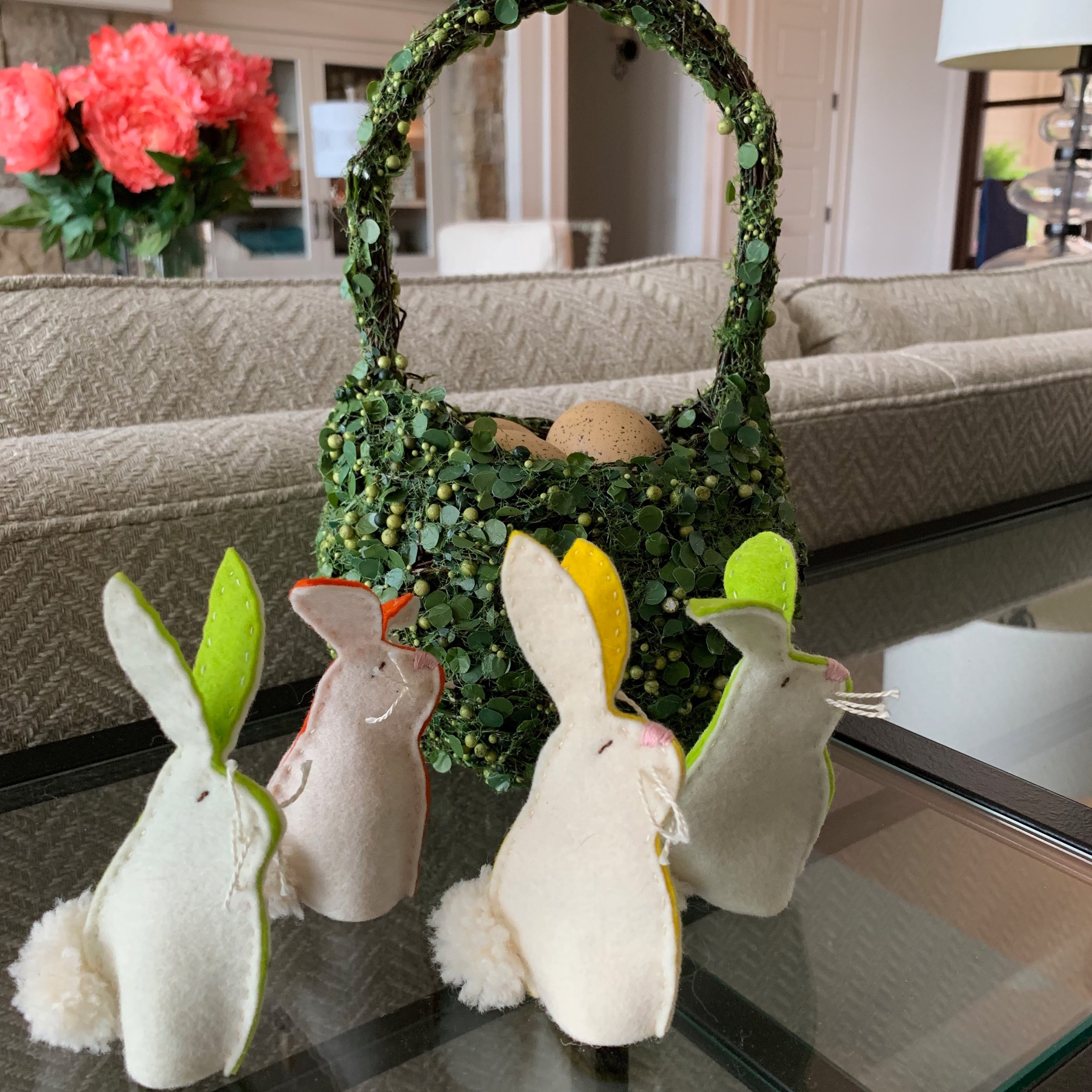 Aren't these bunnies just the cutest? I made them about a dozen years ago and have them around the house. I just noticed one is missing a nose. This sweet basket is from Pottery Barn.