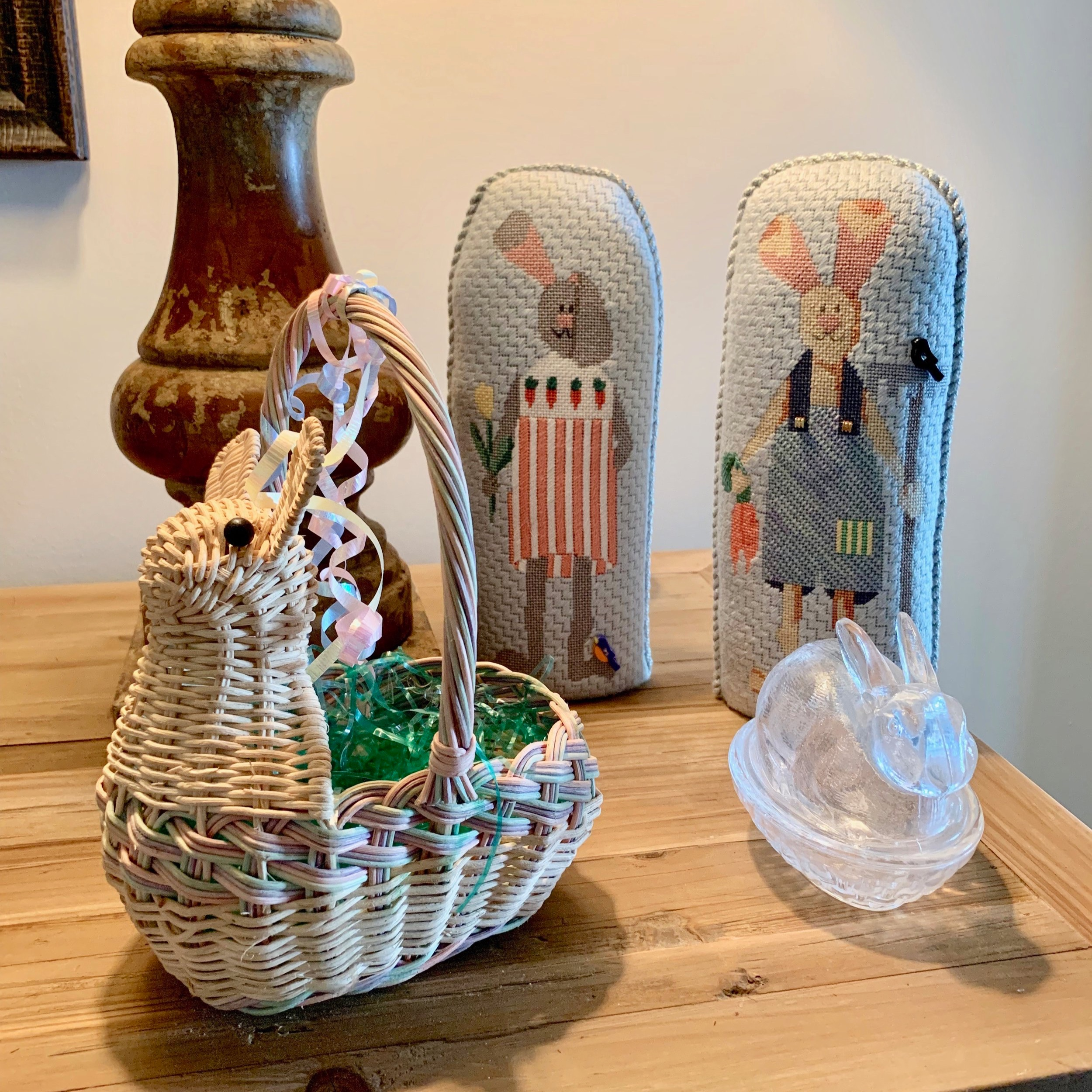A small corner on a table with a few select items. I made those needlepoint bunnies years ago.
