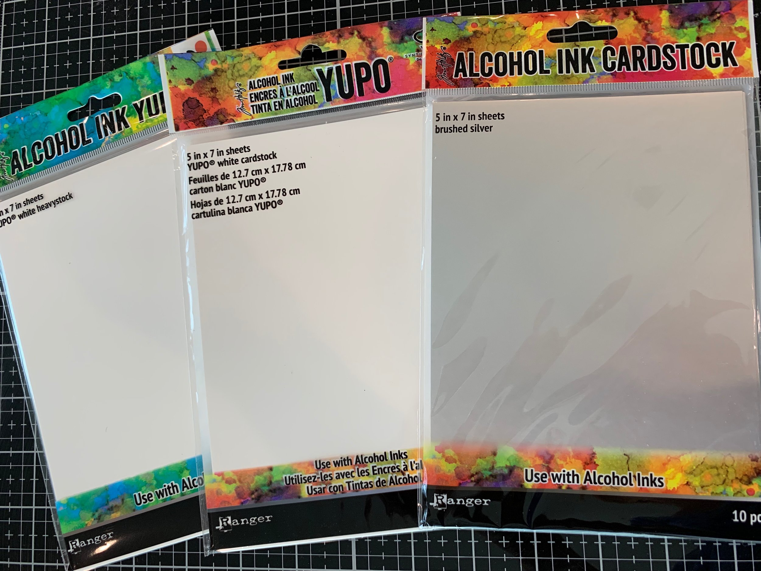 Heavyweight, regular and silver yupo paper.