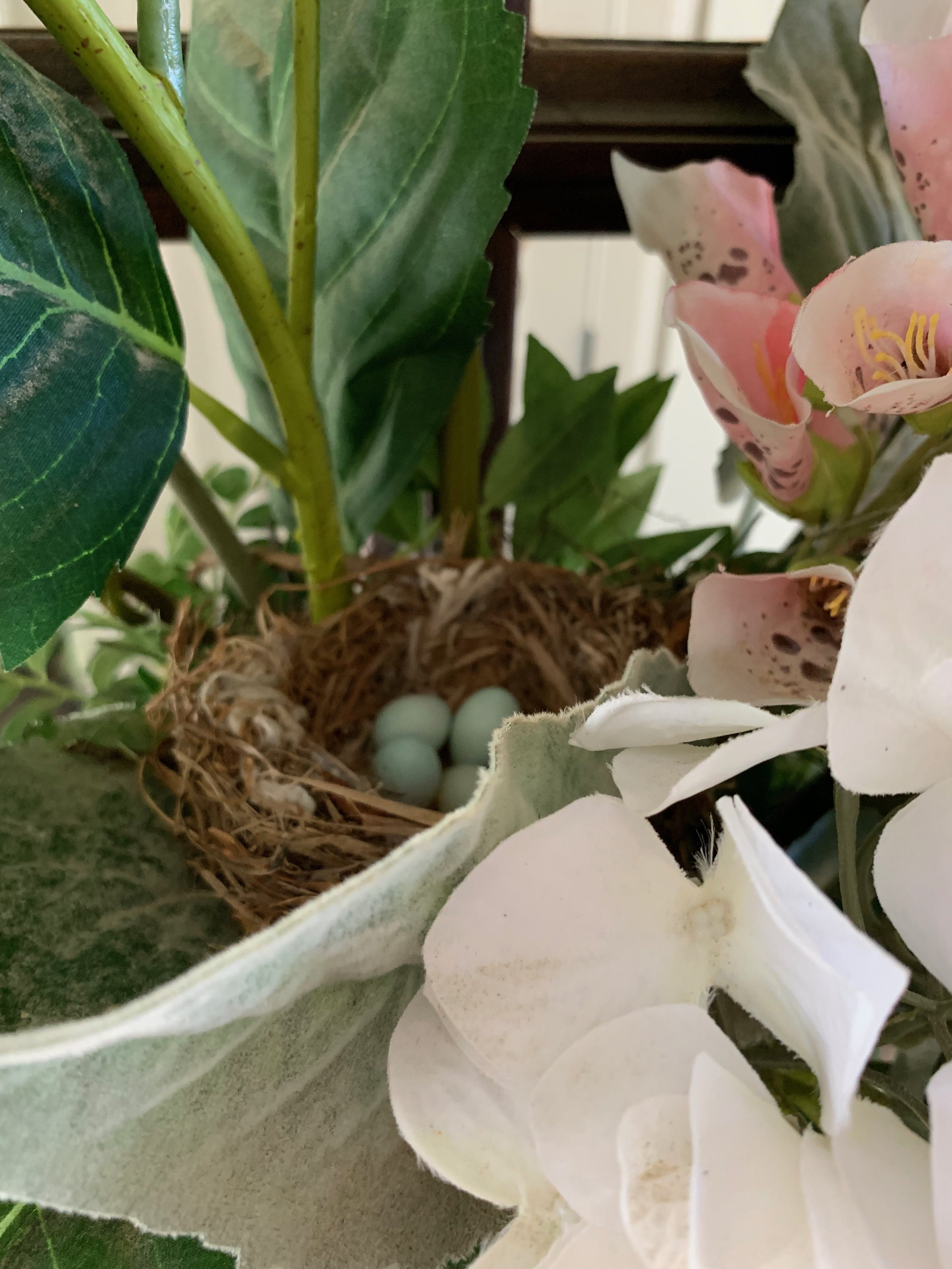 The nest behind the flowers