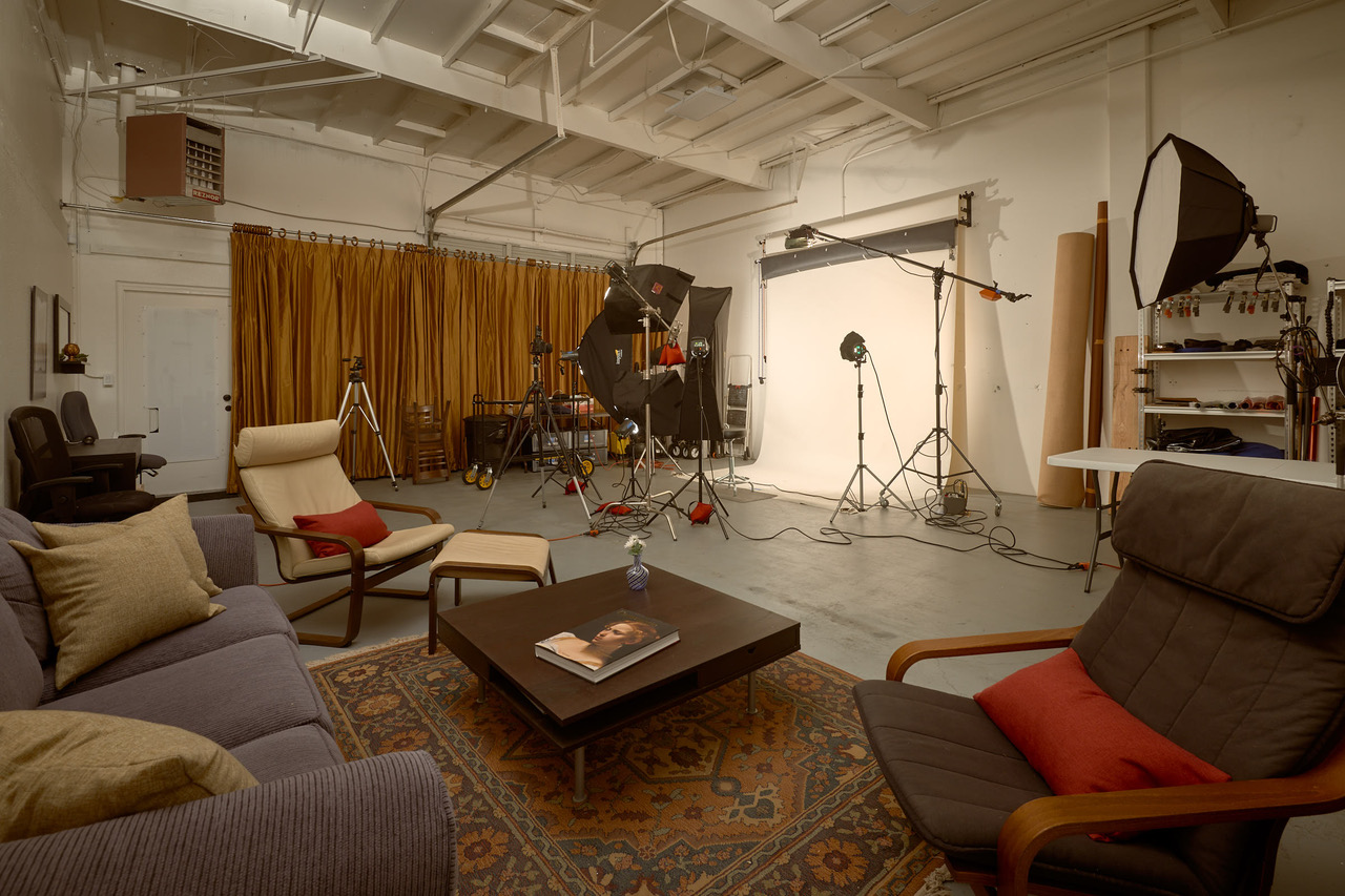 1000 square foot professional photo studio. View of 650 square foot shooting floor from lounge. I love the 15 foot ceiling. No stray bounce light for me. You can see eight of the eleven lights I keep set up and ready to employ at a moments notice.