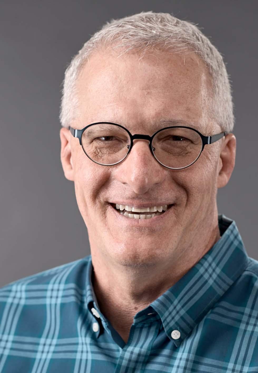 Sam Doying, Headshot showing masculine lighitng with glasses