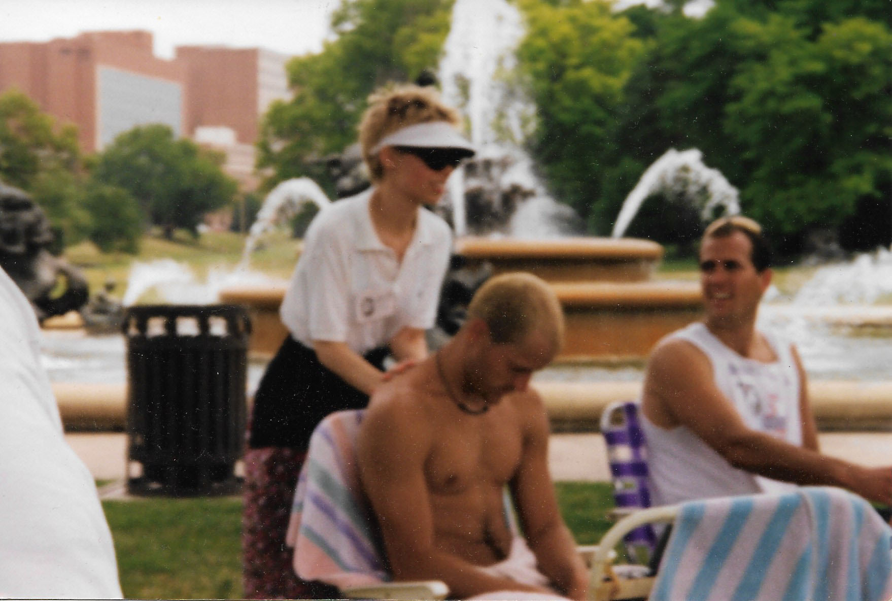 Here is a photo of the owner of Solaris Massage during Massage Awareness Week back in 1997 at Mill Creek Park, KCMO. How 'bout that visor?