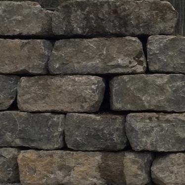 ARMOUR STONE (LIMESTONE) RETAINING WALL