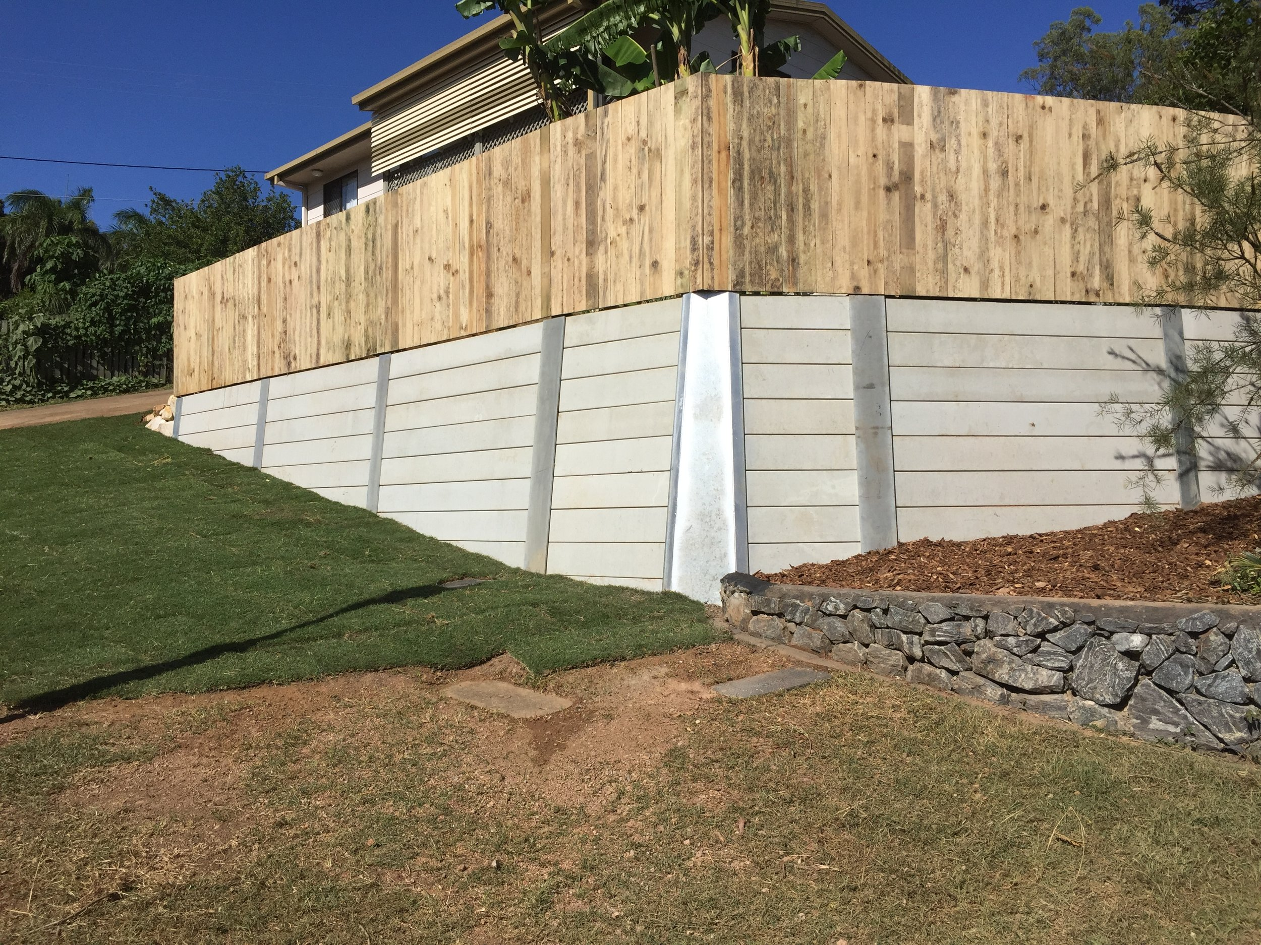 Retaining Walls - By Fassifern having over 33 years experience in landscaping, one of our specialties is retaining walls. Concrete sleeper, Blocks, Sandstone and Wood Retaining Walls are just a few options.