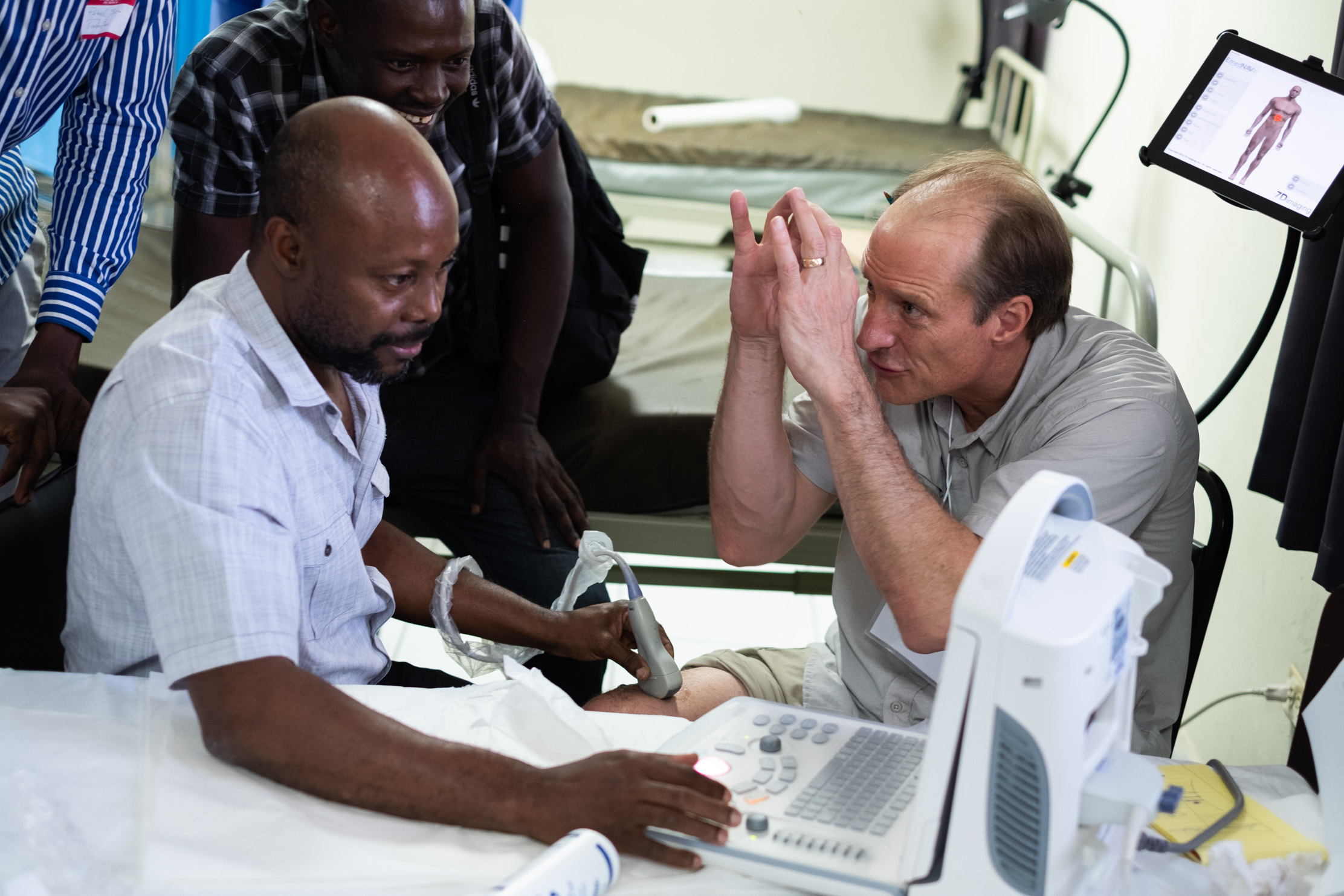 During a hands-on session at Grace Children's Hospital in Port-au-Prince, Haiti, Dr. Gronseth volunteers his own leg to show Dr. Rony Derius how ultrasound 'sees' inside the body.